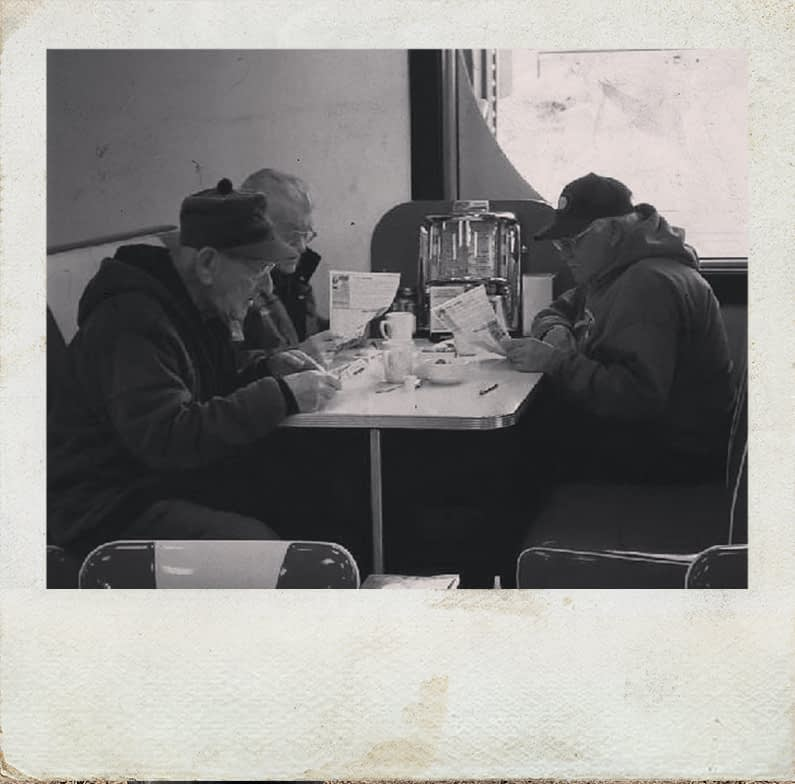 Poloroid of Senior Men Having Lunch at Jennies Diner