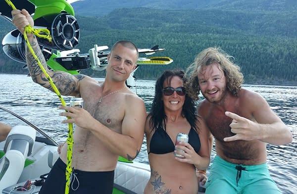 3 boat riders posing